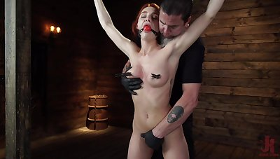 Smiling redhead model Lacey Lennon gets turned on with enslavement