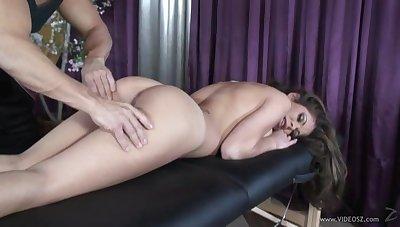 Brunette in high heels gives deepthroat blowjob to masseur