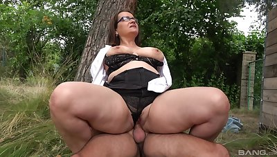 Beamy ass mature rides dick in a parkland together with swallows
