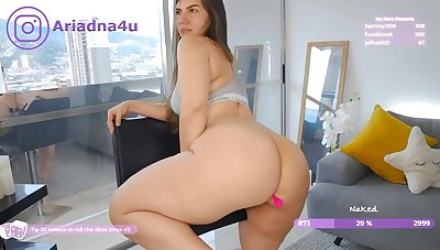 Chubby busty babe shows her ass