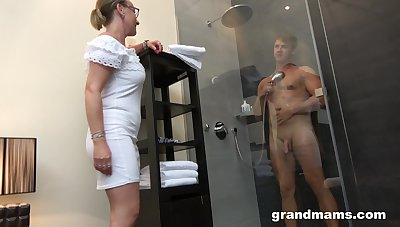 Mummy with contemptuous sex drive enjoys watching young man taking a shower before having sex