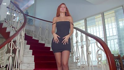 Gorgeous ginger babe Agatha is posing above the stairway
