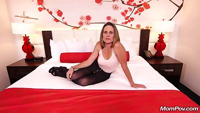 Skinny brunette milf near saggy tits, Judith, is riding a hard white cock for a camera