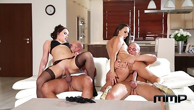 Married women swap their men in a fantastic day-bed foursome