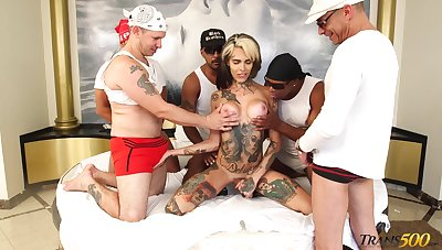 Crowd of big black guys fuck anal hole of tattooed tranny Gaby Ink