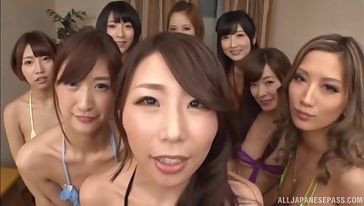 Aroused Japanese girls wait their turn respecting this hard wood