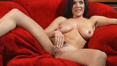 Brunette hottie Rebekah Dee enjoys masturbating on the couch